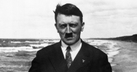 circa 1921:  German dictator Adolf Hitler (1889 - 1945) on board a ferry in the Baltic Sea.  (Photo by Keystone/Getty Images)
